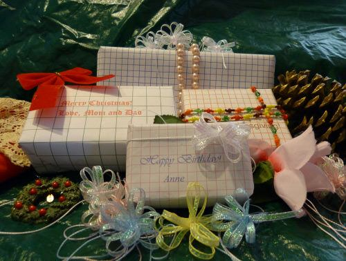 Use PrintNPractice.com interactive graph paper printable PDF Christmas wrap or plot Algebra equations!
